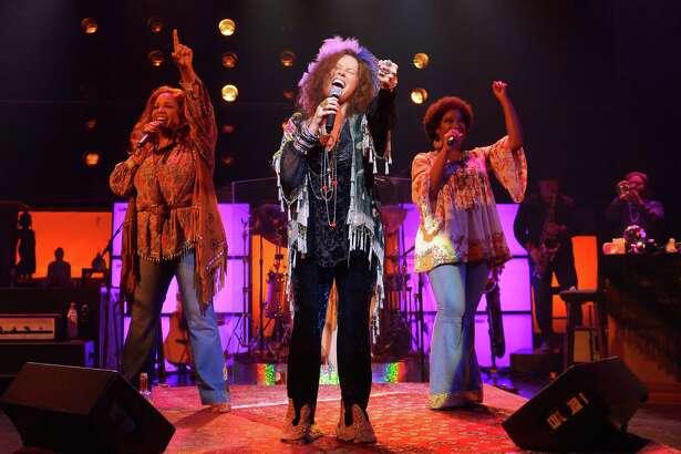 "Kacee Clanton (center) as Janis Joplin accompanied by Sylvia MacCalla and Ashley Ta´mar Davis as Joplinaires in ""A Night with Janis Joplin"" at ACT."