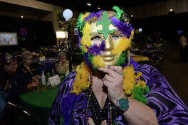 Patti Denson poses with the colorful mask she made for Pardi Gras, a Mardi Gras-themed event hosted by Southeast Texas Circle of Hope, Inc., at the Beaumont Civic Center Saturday night. The organization aimed to bring Mardi Gras back to the Beaumont area while raising money for their non-profit as well as the Human Society of Southeast Texas. Photo taken Saturday, January 24, 2015 Kim Brent/The Enterprise