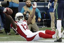 Arizona Cardinals wide receiver Jaron Brown celebrates after making a catch for a touchdown against the Seattle Seahawks in the first half of an NFL football game, Sunday, Dec. 31, 2017, in Seattle.