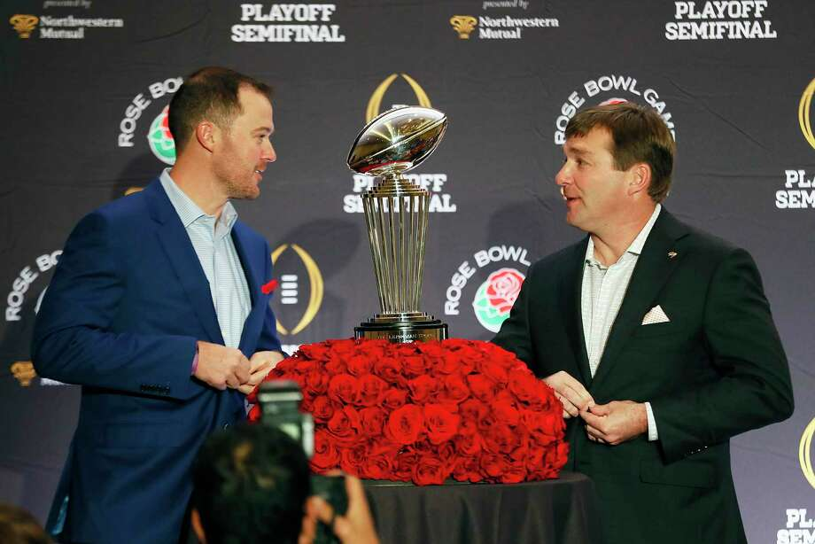 Oklahoma head coach Lincoln Riley, left, and Georgia head coach Kirby Smart speak before a photo session at an NCAA college football news conference, Sunday, Dec. 31, 2017, in Los Angeles. Oklahoma and Georgia meet at the Rose Bowl in a College Football Playoff semifinal on New Year's Day. (Bob Andres/Atlanta Journal-Constitution via AP) Photo: Bob Andres, MBO / 2017 Atlanta Journal Constitution