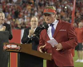 Former Tampa Bay Buccaneers Jon Gruden, addresses the fans as he is inducted into the teams Ring of Honor during halftime at an NFL football game between the Tampa Bay Buccaneers and the Atlanta Falcons, Monday, Dec. 18, 2017, in Tampa, Fla. (AP Photo/Phelan M. Ebenhack)