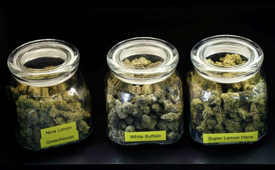Jars of medicinal marijuana are stored under the counter at The Apothecarium dispensary in San Francisco, Calif. on Friday, Dec. 29, 2017. The rules may vary for medicinal cannabis users that hold a locally-issued medical card instead of one officially issued by the state once public sales of marijuana becomes legal Jan. 1. Photo: Paul Chinn, Staff / ONLINE_YES