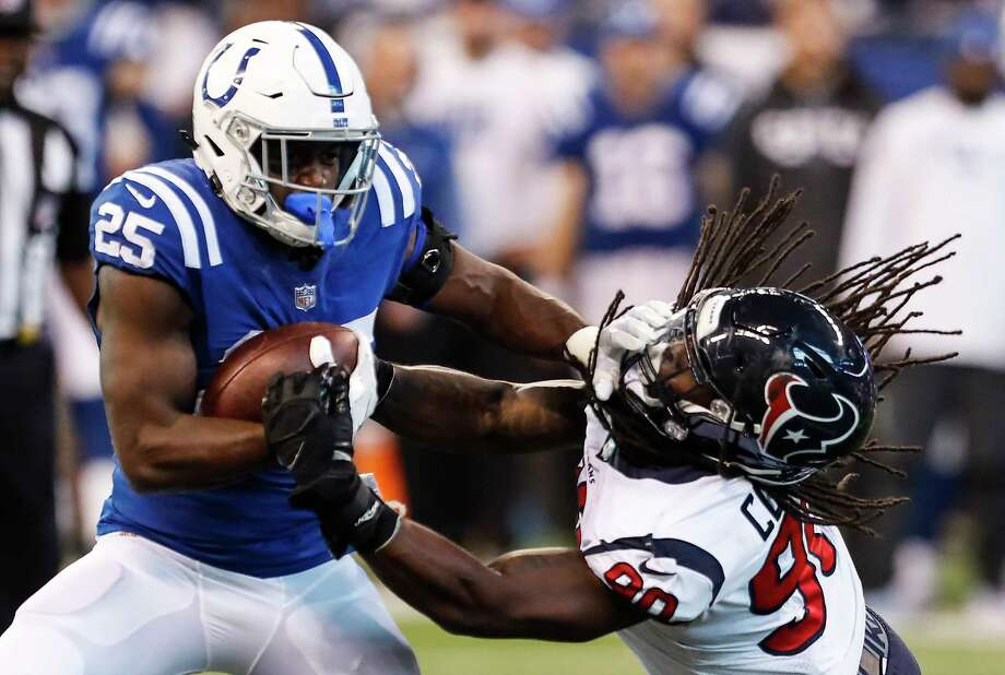 Indianapolis Colts running back Marlon Mack (25) breaks away from Houston Texans outside linebacker Jadeveon Clowney (90) during the third quarter of an NFL football game at Lucas Oil Stadium on Sunday, Dec. 31, 2017, in Indianapolis. ( Brett Coomer / Houston Chronicle ) Photo: Brett Coomer, Staff / © 2017 Houston Chronicle