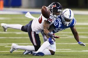 Houston Texans cornerback Kareem Jackson (25) breaks up a pass intended for Indianapolis Colts wide receiver Chester Rogers (80) during the second quarter of an NFL football game at Lucas Oil Stadium on Sunday, Dec. 31, 2017, in Indianapolis. ( Brett Coomer / Houston Chronicle )