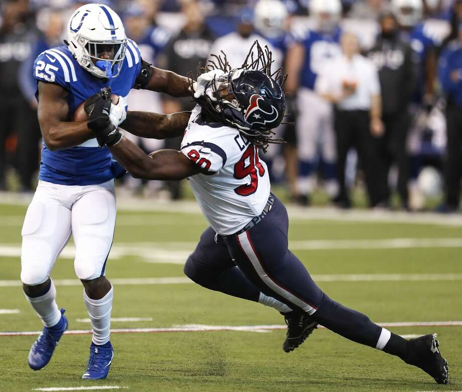Indianapolis Colts running back Marlon Mack (25) breaks away from Houston Texans outside linebacker Jadeveon Clowney (90) during the third quarter of an NFL football game at Lucas Oil Stadium on Sunday, Dec. 31, 2017, in Indianapolis. ( Brett Coomer / Houston Chronicle ) Photo: Brett Coomer/Houston Chronicle