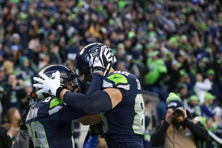 Seahawks wide receiver Doug Baldwin makes a touchdown against the Arizona Cardinals in the second half of an NFL football game, Sunday, Dec. 31, 2017, in Seattle. Photo: GENNA MARTIN, SEATTLEPI