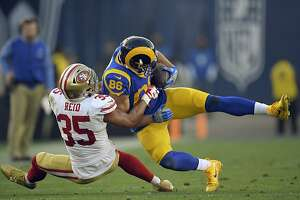 Los Angeles Rams tight end Derek Carrier, right, is tackled by San Francisco 49ers strong safety Eric Reid during the second half of an NFL football game, Sunday, Dec. 31, 2017, in Los Angeles. (AP Photo/Mark J. Terrill)