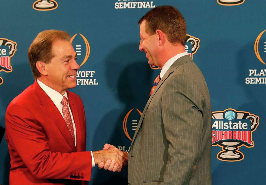 Alabama's Nick Saban and Clemson's Dabo Swinney meet again in the College Football Playoff, but this time it will be in the semifinals for a spot in the final. Photo: Gerald Herbert, STF / Copyright 2017 The Associated Press. All rights reserved.