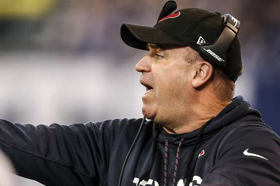 Houston Texans head coach Bill O'Brien makes a call fropm the sidelines during the second quarter of an NFL football game against the Indianapolis Colts at Lucas Oil Stadium on Sunday, Dec. 31, 2017, in Indianapolis. ( Brett Coomer / Houston Chronicle )