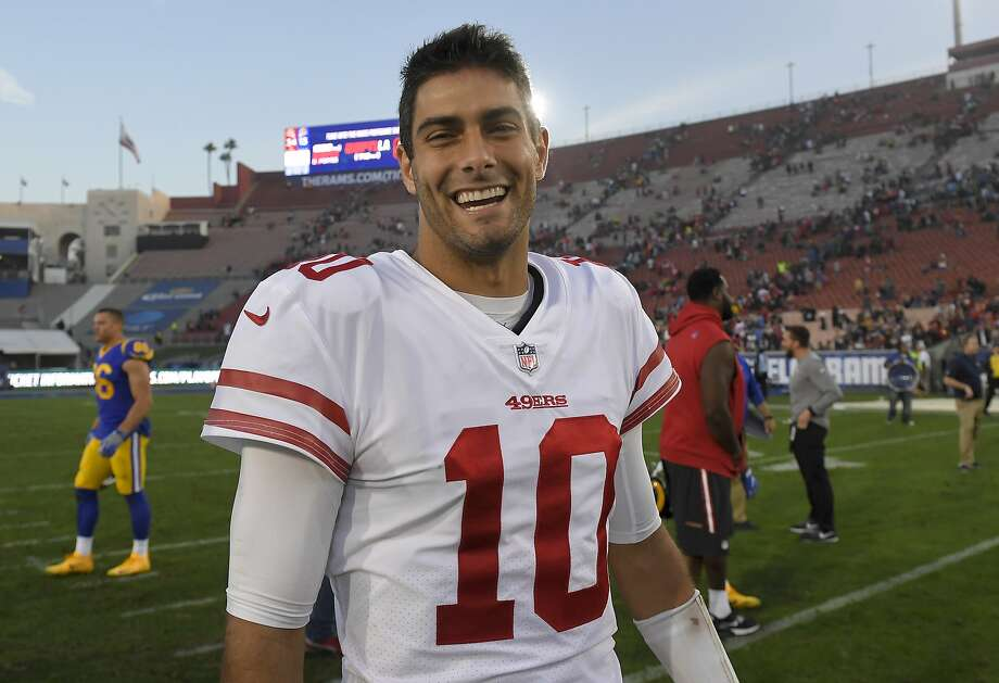 Undefeated quarterback Jimmy Garoppolo has a smile that could sell in Hollywood. It's a good thing the 49ers don't have to compete with Hollywood's money to keep him. Photo: Mark J. Terrill, Associated Press