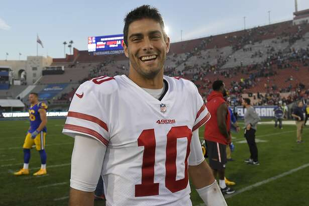 San Francisco 49ers quarterback Jimmy Garoppolo smiles as he walks off the field after their 34-13 win against the Los Angeles Rams during the second half of an NFL football game Sunday, Dec. 31, 2017, in Los Angeles. (AP Photo/Mark J. Terrill)