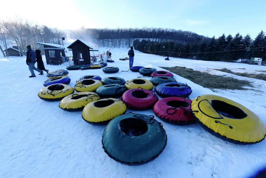 People enjoy tubing at Maple Ski Ridge on Sunday, Dec. 31, 2017, in Rotterdam, N.Y.  Ski and snowboard lessons begin this week at the ski hill with a new home-schooling lessons, which are held during the day on Thursdays and Fridays.  The ski hill has tubing on the weekends and on Mondays and Tuesdays they hold Nordic Night from 4:00pm to 7:00pm.  Downhill skiing hours at Maple Ski Ridge are Wednesdays from 3:00pm to 8:00pm, Thursdays and Fridays from noon to 8:00pm and Saturday's and Sunday's from 9:00am to 6:00pm.     (Paul Buckowski / Times Union) Photo: PAUL BUCKOWSKI / 20042525A