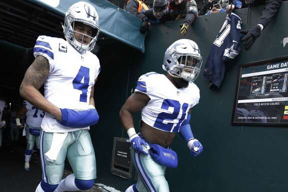 Dallas Cowboys' Dak Prescott, left, and Ezekiel Elliott run onto the field before an NFL football game against the Philadelphia Eagles, Sunday, Dec. 31, 2017, in Philadelphia. (AP Photo/Chris Szagola)