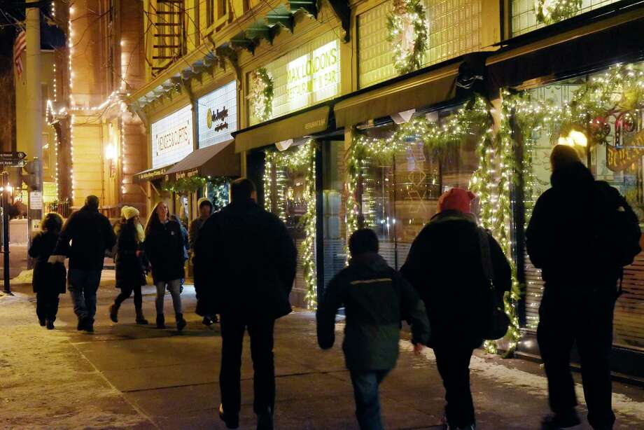 People are bundled up against the cold temperatures as they make their way along Broadway during Saratoga First Night on Sunday, Dec. 31, 2017, in Saratoga Springs, N.Y.      (Paul Buckowski / Times Union) Photo: PAUL BUCKOWSKI, Albany Times Union / 20042508A