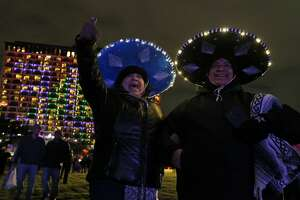 "Juanita and Miguel Villarreal take in the sights during San Antonio's ""Celebrate 300"" New Year's Eve festival held Sunday Dec. 31, 2017."