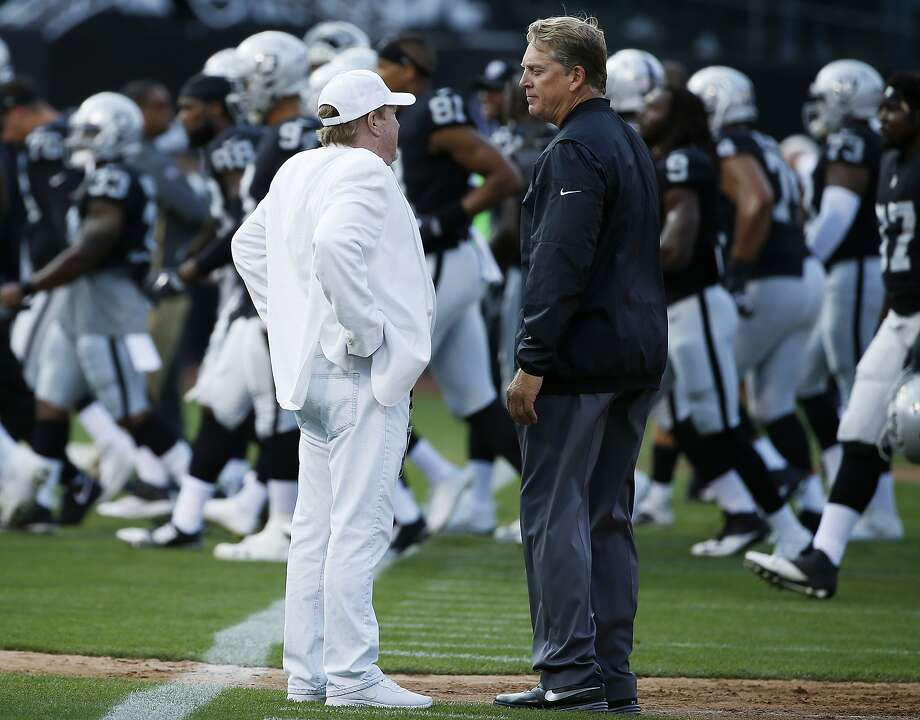Raider head coach Jack Del Rio (right) said he had been fired by owner Mark Davis (left). Photo: Santiago Mejia, The Chronicle