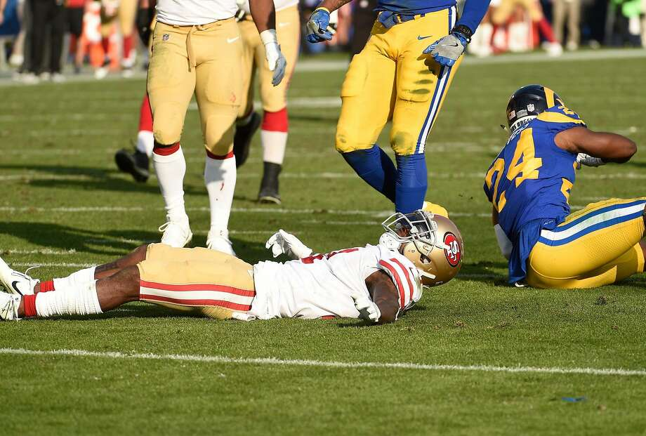 LOS ANGELES, CA - DECEMBER 31: Marquise Goodwin #11 of the San Francisco 49ers lays on the football field after after a hit by Blake Countess #24 of the Los Angeles Rams during the second quarter at Los Angeles Memorial Coliseum on December 31, 2017 in Los Angeles, California. (Photo by Kevork Djansezian/Getty Images) Photo: Kevork Djansezian, Getty Images