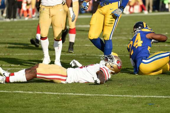 LOS ANGELES, CA - DECEMBER 31: Marquise Goodwin #11 of the San Francisco 49ers lays on the football field after after a hit by Blake Countess #24 of the Los Angeles Rams during the second quarter at Los Angeles Memorial Coliseum on December 31, 2017 in Los Angeles, California. (Photo by Kevork Djansezian/Getty Images)