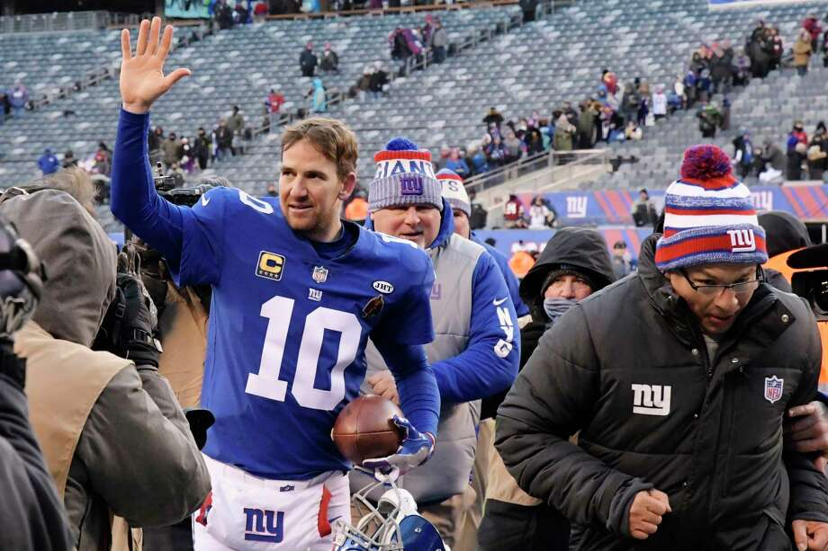 New York Giants quarterback Eli Manning (10) waves to fans after an NFL football game against the Washington Redskins, Sunday, Dec. 31, 2017, in East Rutherford, N.J. The Giants won 18-10. (AP Photo/Bill Kostroun) Photo: Bill Kostroun / FR51951 AP