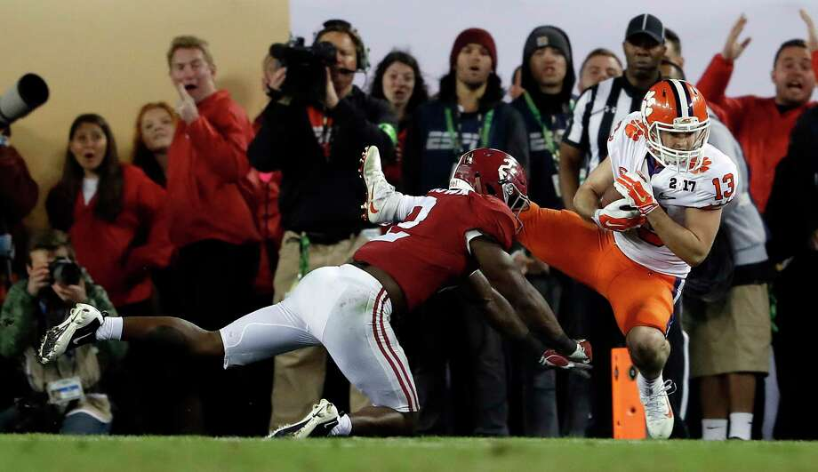 FILE- In this Jan. 10, 2017, file photo, Clemson's Hunter Renfrow, right, catches a touchdown pass in front of Alabama's Tony Brown during the second half of the NCAA college football playoff championship game in Tampa, Fla. Renfrow, a former walk-on, made the catch with 1 second left that gave Clemson a win over Alabama in the College Football Playoff championship game. (AP Photo/John Bazemore, File) Photo: John Bazemore / Copyright 2017 The Associated Press. All rights reserved.