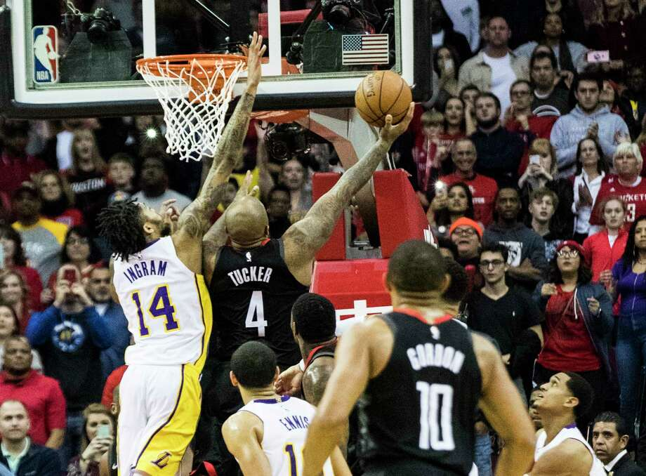 Rockets forward P.J. Tucker (4) scores against Lakers forward Brandon Ingram (14) with 5.7 seconds remaining in the second overtime to give the Rockets the lead Sunday night at Toyota Center. Photo: Marie D. De Jesus, Houston Chronicle / © 2017 Houston Chronicle