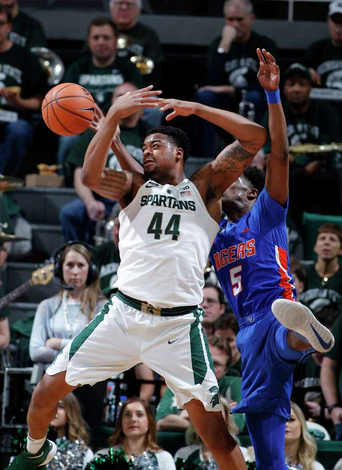 Michigan State's Nick Ward (44) is fouled by Savannah State's Javaris Jenkins during the first half of an NCAA college basketball game, Sunday, Dec. 31, 2017, in East Lansing, Mich. (AP Photo/Al Goldis) Photo: Al Goldis / FR11125 AP