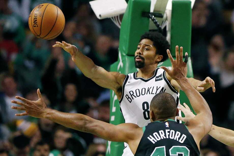 Brooklyn Nets' Spencer Dinwiddie (8) passes the ball over Boston Celtics' Al Horford (42) during the fourth quarter of an NBA basketball game in Boston, Sunday, Dec. 31, 2017. The Celtics won 108-105. (AP Photo/Michael Dwyer) Photo: Michael Dwyer / AP2017
