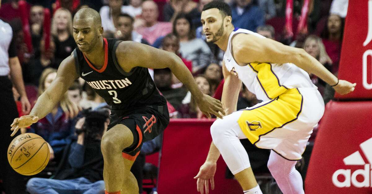 Houston Rockets guard Chris Paul (3) dribbles the ball under the pressure of Los Angeles Lakers forward Larry Nance Jr. (7) during the fifth period, Sunday, Dec. 31, 2017, in Houston. ( Marie D. De Jesus / Houston Chronicle )