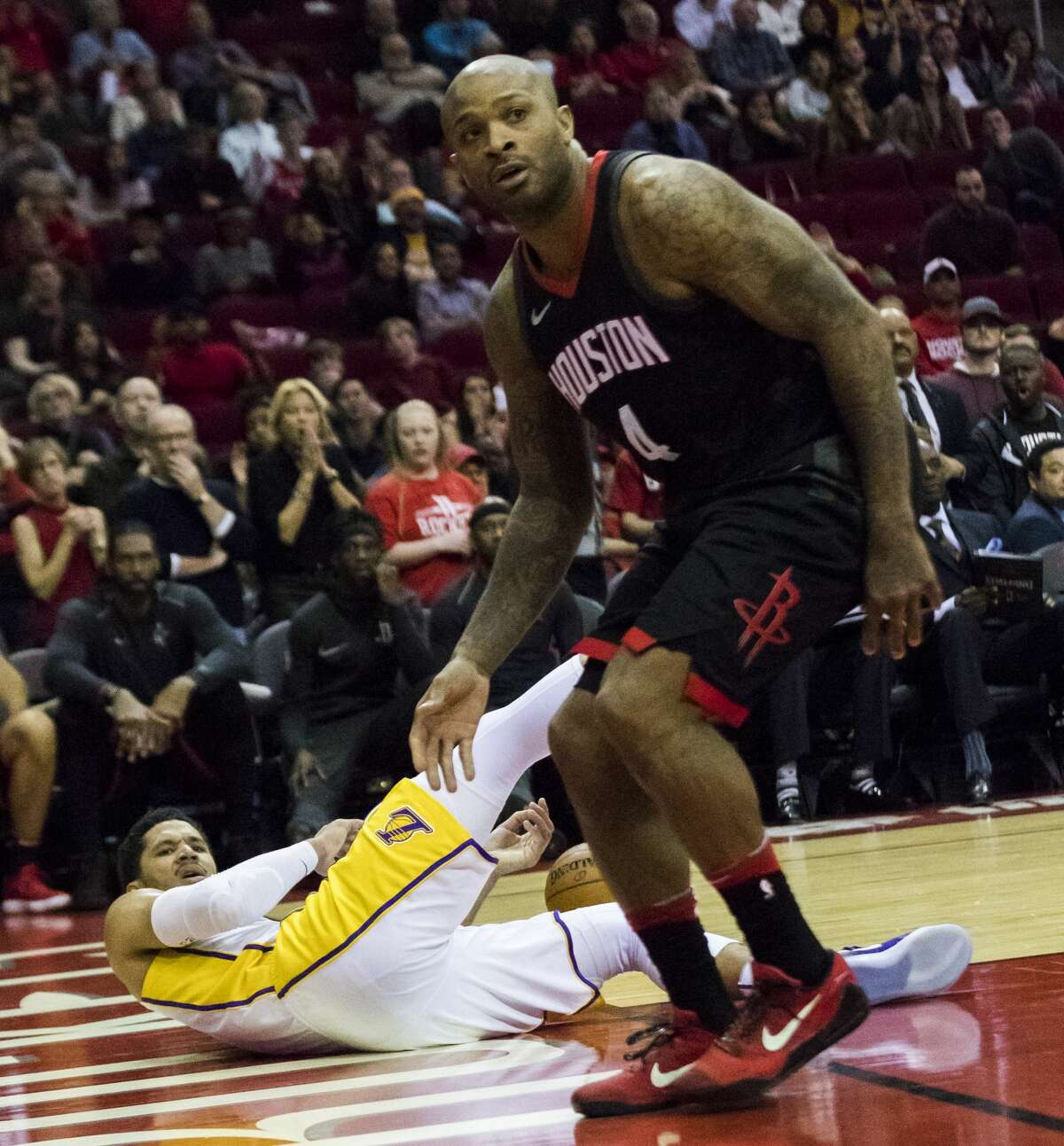 Los Angeles Lakers guard Josh Hart (5) is fouled by Houston Rockets forward PJ Tucker (4) during the sixth period, Sunday, Dec. 31, 2017, in Houston. The Rockets won 148-142. ( Marie D. De Jesus / Houston Chronicle )