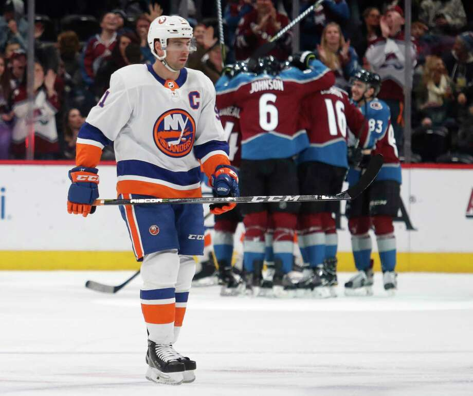 New York Islanders center John Tavares skates past Colorado Avalanche players celebrating a goal by Matt Nieto during the second period of an NHL hockey game Sunday, Dec. 31, 2017, in Denver. (AP Photo/David Zalubowski) Photo: David Zalubowski / Copyright 2017 The Associated Press. All rights reserved.