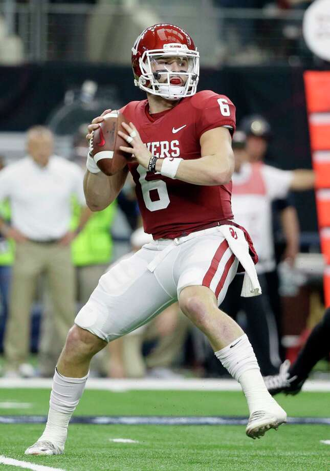 File-This Dec. 2, 2017, file photo shows Oklahoma quarterback Baker Mayfield (6) dropping back to pass in the first half of the Big 12 Conference championship NCAA college football game against TCU in Arlington, Texas.  Mayfield, offensive tackle Orlando Brown and tight end Mark Andrews of Oklahoma were selected to the Associated Press All-America team, giving the Sooners more players on the first team than any school. The All-America team, selected by a panel of 17 Top 25 voters, was released Monday, Dec. 11, 2017.  (AP Photo/Tony Gutierrez, File) ORG XMIT: NYSH901 Photo: Tony Gutierrez / Copyright 2017 The Associated Press. All rights reserved.
