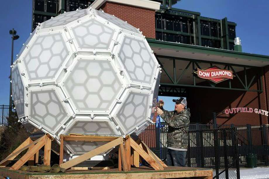 Sound Productions arrives at Dow Diamond with the New Year's Eve ball on Sunday afternoon. The ball has 2.1 million lights and will be lowered 180 feet during the Midnight on Main celebration. (Samantha Madar/for the Daily News)