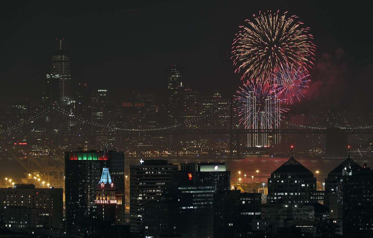 Fireworks over the San Francisco Bay ring in the new year with downtown Oakland and San Francisco are visible from the hills in Oakland, Calif., on Monday, January 1, 2018.