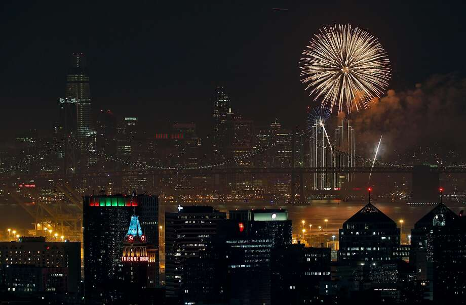 Fireworks over the San Francisco Bay ring in the new year with downtown Oakland and San Francisco are visible from the hills in Oakland, Calif., on Monday, January 1, 2018. Photo: Carlos Avila Gonzalez, The Chronicle