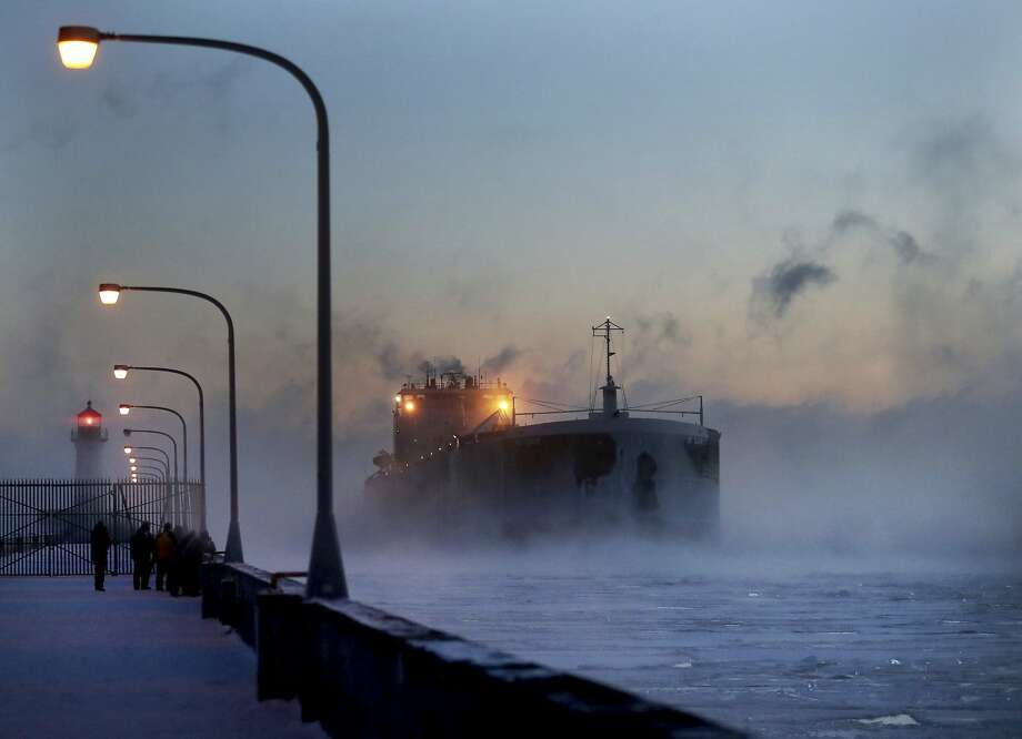 Steam rises from Lake Superior as a freighter comes into harbor Sunday in Duluth, Minn. The wind chill dipped to 36 below zero in the city known for its brutally cold winters. Photo: David Joles, Associated Press