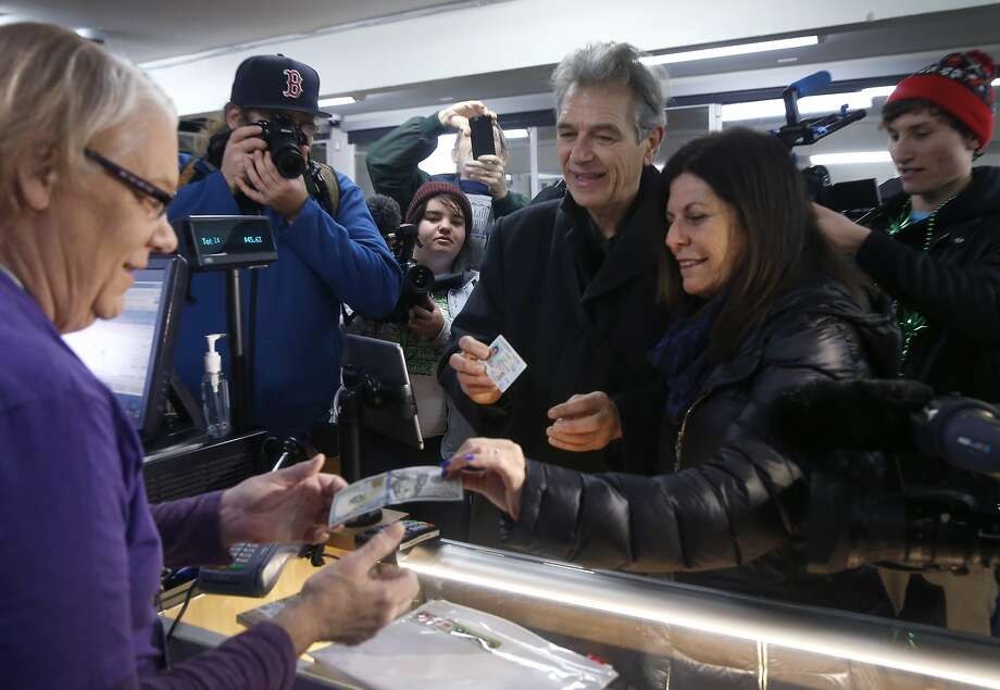 Chris Conrad and his wife Mikki Morris (right) are the first customers to purchase legalized marijuana at the Berkeley Patients Group dispensary on the first day of recreational cannabis sales in Berkeley, Calif. on Monday, Jan. 1, 2018. Assisting them with the transaction is Sue Gardea (left). The Berkeley City Council is considering a measure to declare the city a sanctuary for legal adult-use cannabis, resisting federal attempts at marijuana enforcement. Photo: Paul Chinn, The Chronicle