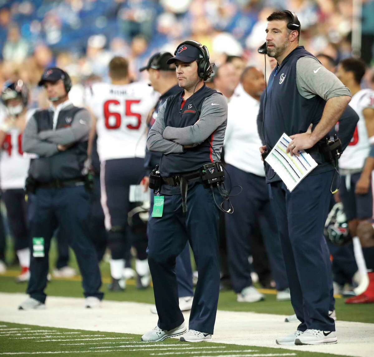 Houston Texans secdondary coach John Butler, left, and defensive coordinator Mike Vrabel stand on the sidelines during the fourth quarter of an NFL football game against the Indianapolis Colts at Lucas Oil Stadium on Sunday, Dec. 31, 2017, in Indianapolis.