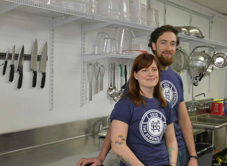 Lucas Serwinski and Gabriel Morris, husband and wife, operate a meal preparation and delivery business, The Strong Kitchen, in Hamden, which focuses on cooking healthful whole foods. Photo: Clare Dignan / Hearst Connecticut Media
