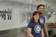 Lucas Serwinski and Gabriel Morris, husband and wife, operate a meal preparation and delivery business, The Strong Kitchen, in Hamden, which focuses on cooking healthful whole foods.