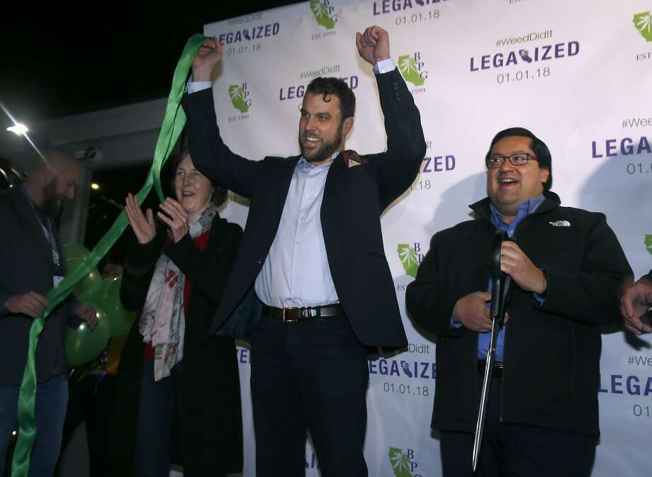From left, state Senator Nancy Skinner, Berkeley Patients Group COO Sean Luse and Berkeley Mayor Jesse Arreguin cut the ribbon at the cannabis dispensary on the first day of legalized recreational marijuana sales in Berkeley, Calif. on Monday, Jan. 1, 2018. Photo: Paul Chinn, The Chronicle