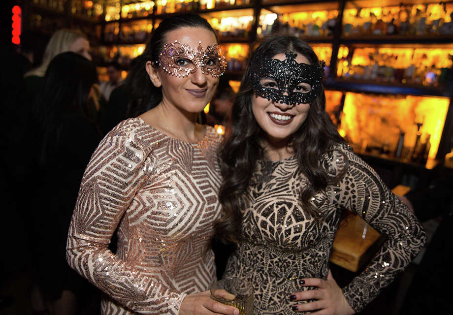 "In the final moments of 2017 and the first ones of 2018, New Year's Eve revelers enjoyed ""delectable bites, electrifying elixirs and intoxicating performances"" at Paramour. The San Antonio rooftop bar hosted its second annual Midnight Masquerade on Dec. 31, 2017. Photo: B. Kay Richter, For MySA.com"