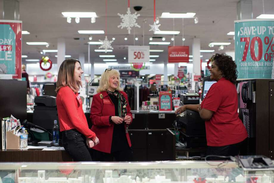 Co-workers share a laugh with Barbara Cake (cener) behind the jewelry counter at J.C. Penney in Hermitage, Pennsylvania on December 23, 2017. Photo: Dustin Franz For The Washington Post. / Dustin Franz for The Washington Post