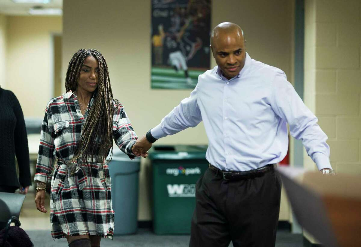 Houston Texans general manager Rick Smith brings his wife, Tiffany, up to the front of the media workroom at NRG Stadium, Monday, Jan. 1, 2018, in Houston. Smith announced that he will be taking an extended leave of absence to help care for his wife, Tiffany, who was diagnosed with breast cancer in 2017, Smith said.