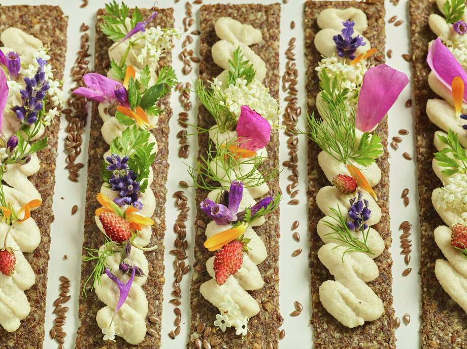This Dec. 12, 2017 photo provided by The Culinary Institute of America shows almond and flax crackers with a smoked almond spread in Hyde Park, N.Y. This dish is from a recipe by the CIA. (Phil Mansfield/The Culinary Institute of America via AP) Photo: Phil Mansfield, HONS / © 2017 The Culinary Institute of America - Phil Mansfield