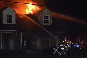 Port Neches emergency responders fight a house fire on the 2600 block of Merriman Street while many celebrate the new year Sunday night. Two other fires occured the next morning on the 2500 block of Pecos in Beaumont and at the insection of Clover Street and Dogwood Drive in VIdor. No major injuries were reported. Photo provided by Eric Williams.