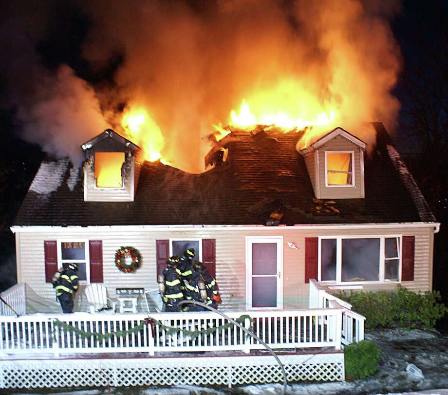 Danbury firefighters responded to a blaze at the home of one of their retired members on Fleetwood Drive on Sunday afternoon. Photo: Contributed Photo / Rob Fish