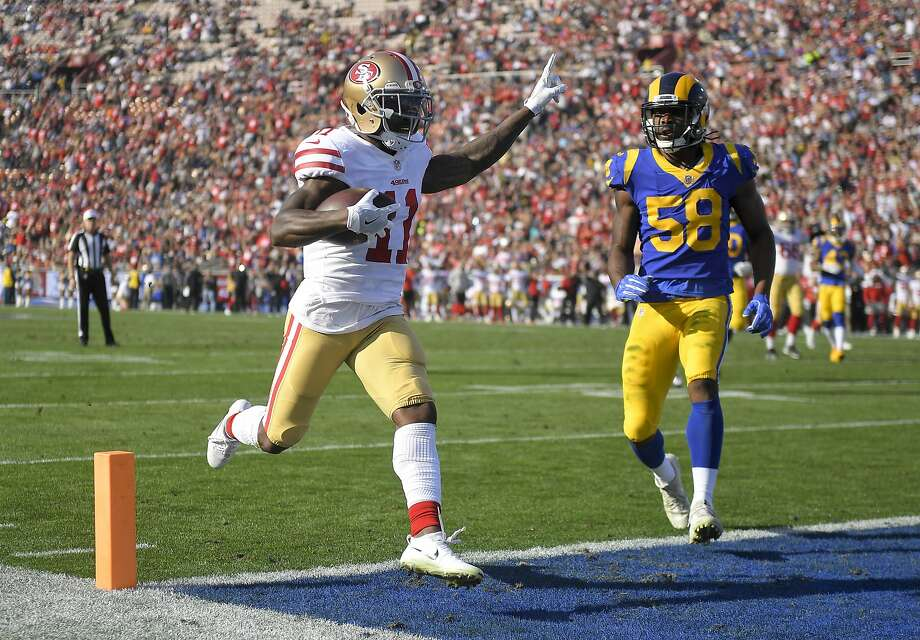 San Francisco 49ers wide receiver Marquise Goodwin celebrates after scoring during the first half of an NFL football game against the Los Angeles Rams Sunday, Dec. 31, 2017, in Los Angeles.  Photo: Mark J. Terrill, Associated Press
