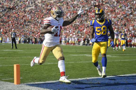 San Francisco 49ers wide receiver Marquise Goodwin celebrates after scoring during the first half of an NFL football game against the Los Angeles Rams Sunday, Dec. 31, 2017, in Los Angeles. (AP Photo/Mark J. Terrill)