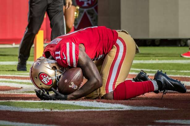 SANTA CLARA, CA - NOVEMBER 12: San Francisco 49ers wide receiver Marquise Goodwin (11) breaks down in grief after his touchdown run during the regular season game between the New York Giants verses the San Francisco 49ers on Sunday, November 12, 2017 at Levi's Stadium in Santa Clara, CA (Photo by Douglas Stringer/Icon Sportswire via Getty Images)