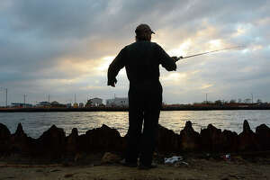 "Rick Waynick, or ""Rollover Rick"" as he is known among the regulars who fish at Rollover Pass in the Bolivar Peninsula, gets in some late day fishing before sundown Wednesday. Waynick has been fishing at the popular waterway between the Gulf and East Bay for 30 years and has a number of reasons why he believes the pass should remain open. The Galveston County Commissioners Court recently voted to close Rollover Pass, which is part of the land owned by the Galveston Rod, Reel, and Gun Club. After sealing the connecting waterway, plans may be to build a state or county park with fishing piers extending out into the Gulf. Photo taken Wednesday, January 20, 2016 Kim Brent/The Enterprise"